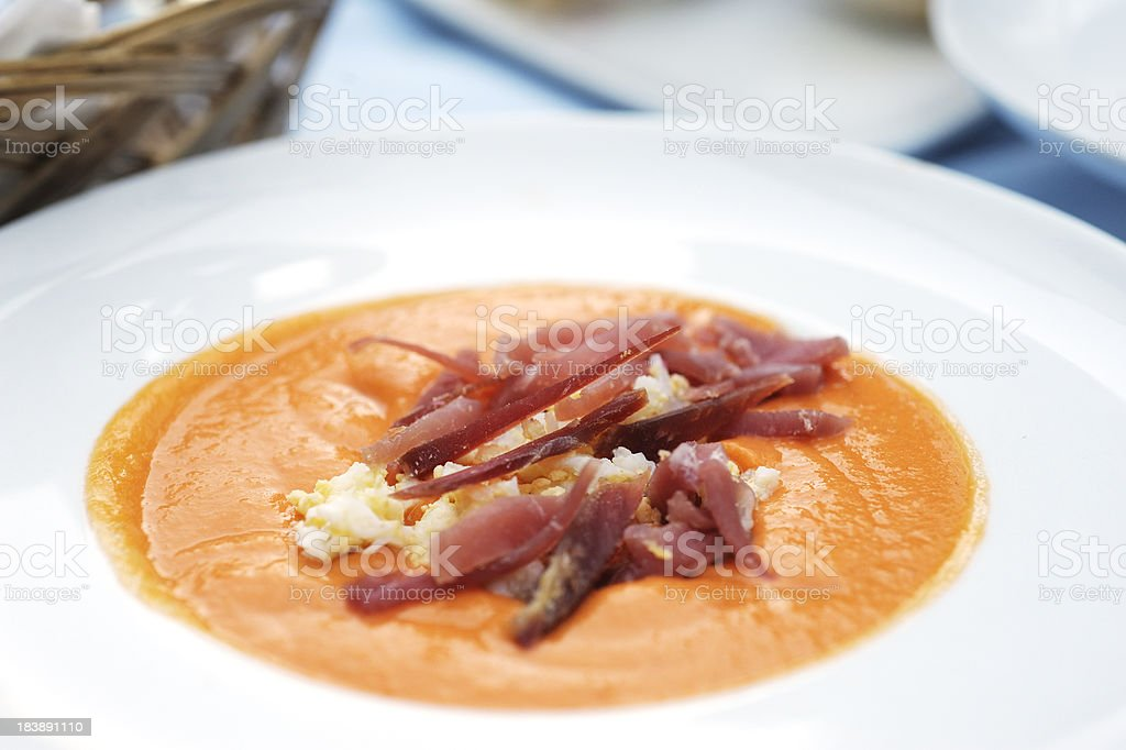"""Chilled Salmorejo soup """"** Shallow DOF ** Chilled Spanish soup, like gazpacho but thicker with more breadcrumbs - the Cordoban speciality known as Salmorejo"""" Appetizer Stock Photo"""
