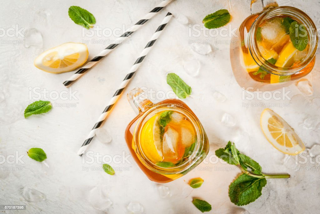 Chilled summer tea with mint and lemon stock photo