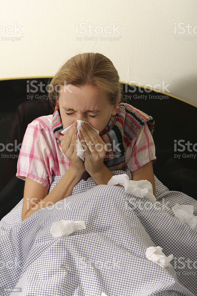 Chilled woman in bed royalty-free stock photo
