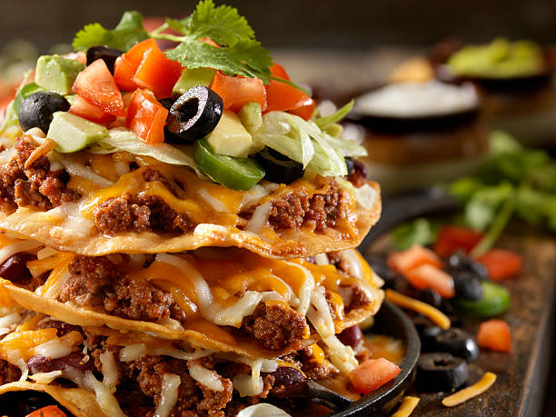 chilli cheese tostada tower - mexican food stock photos and pictures