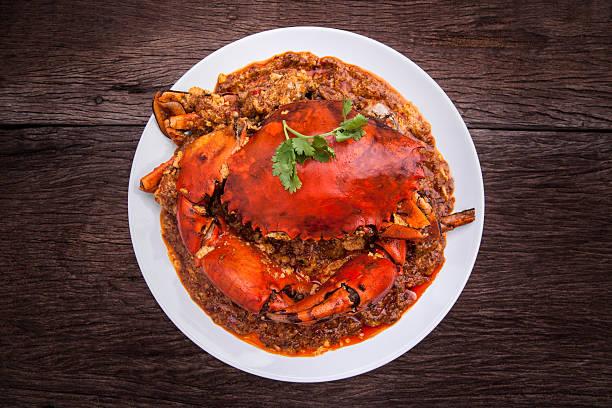 crabe au piment de la cuisine de l'asie. - crabe photos et images de collection
