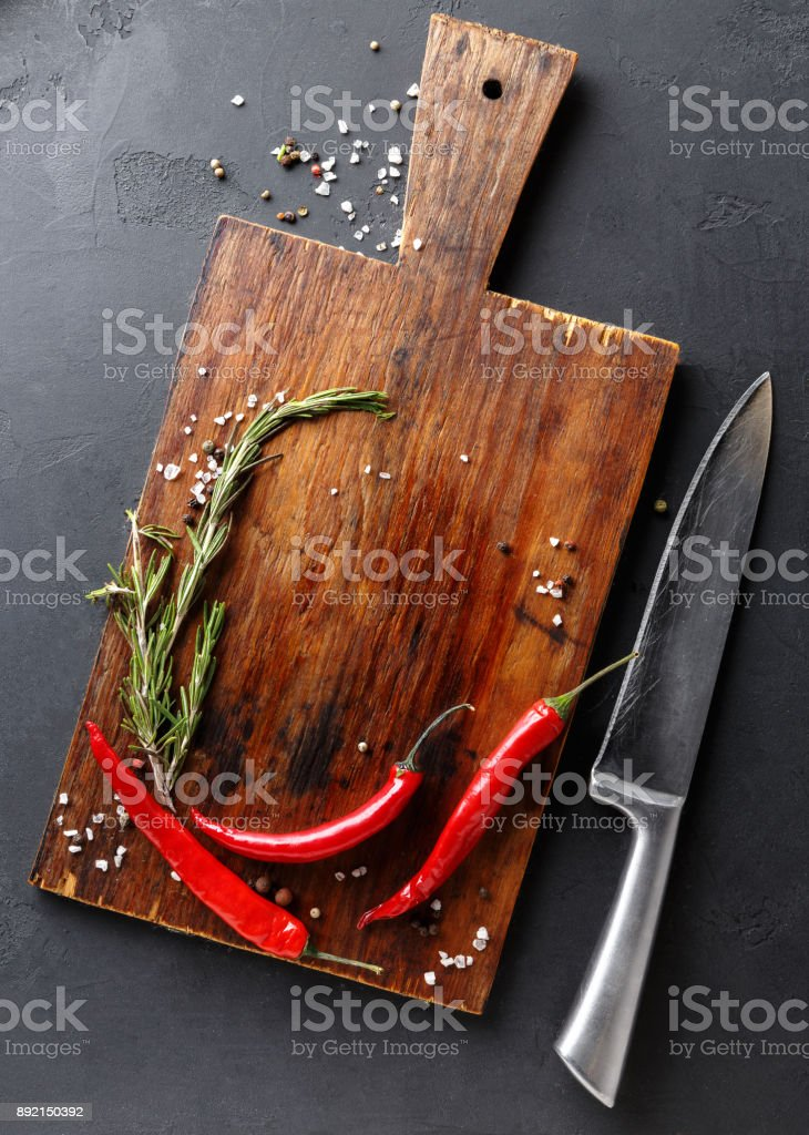 Chilli on wooden board, top view stock photo