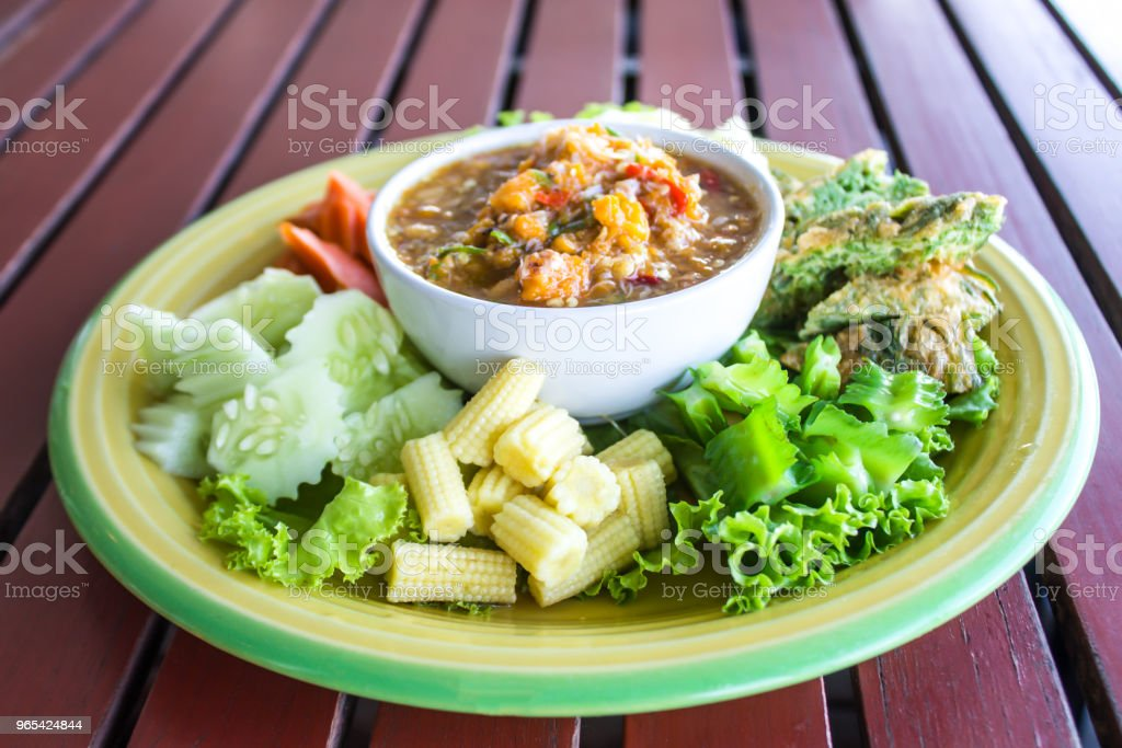 Chilli paste with many vegetables, corn, cucumber and fried egg is Thai food. Have a delicious spicy taste. royalty-free stock photo