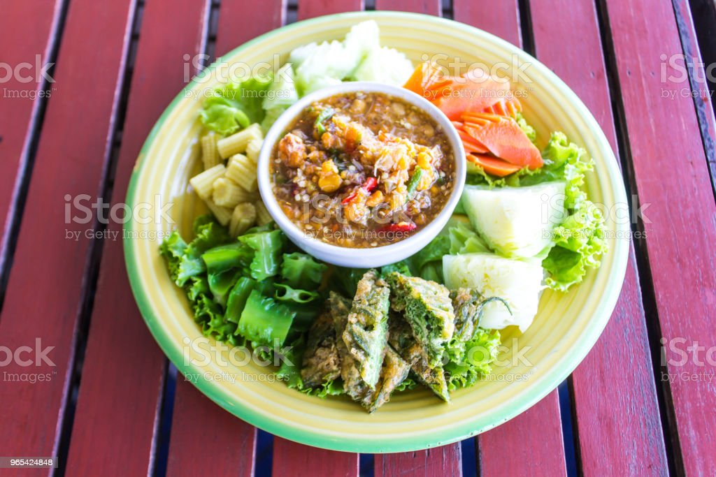 Chilli paste with many vegetables, corn, cucumber and fried egg is Thai food. Have a delicious spicy taste. zbiór zdjęć royalty-free