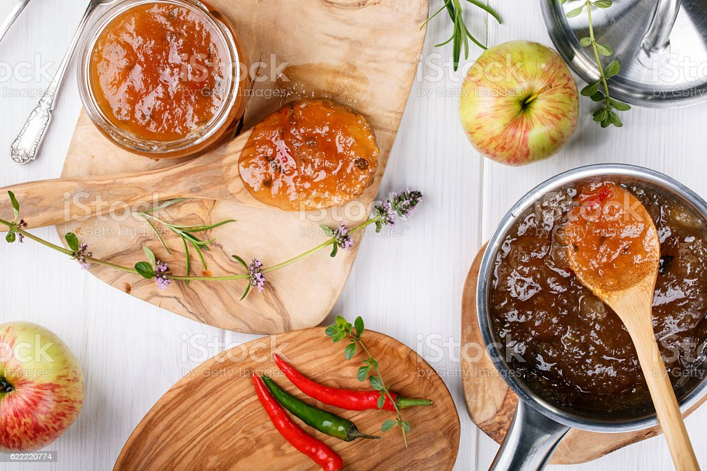 Chilli pepper apple jam with herbs. stock photo