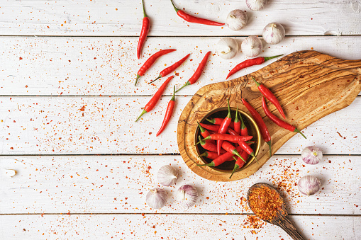 Chilli Peppers And Garlic Background Stock Photo - Download Image Now