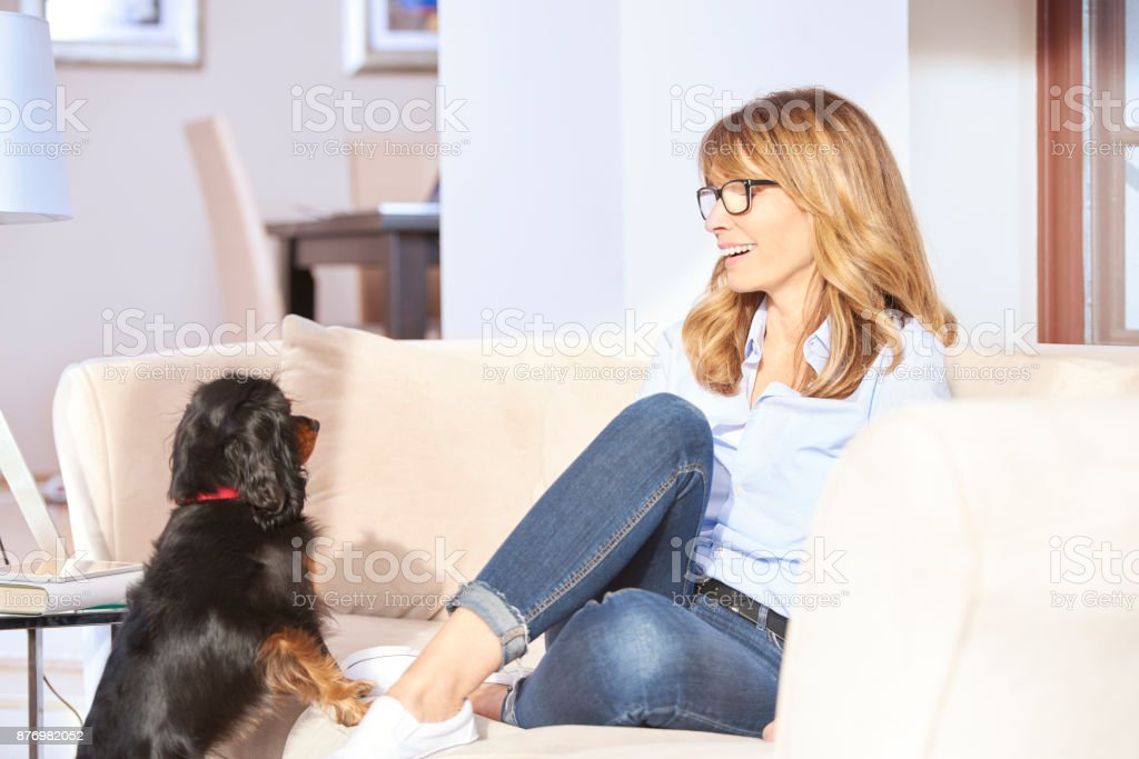 Chilling at home with her furry friend stock photo