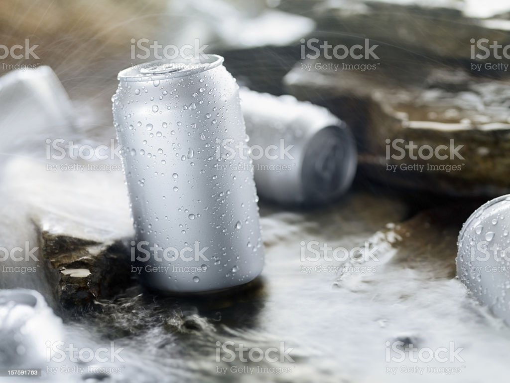 Chilling Beer in a Stream stock photo