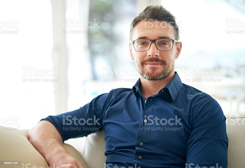 Chilling on the couch for a while stock photo