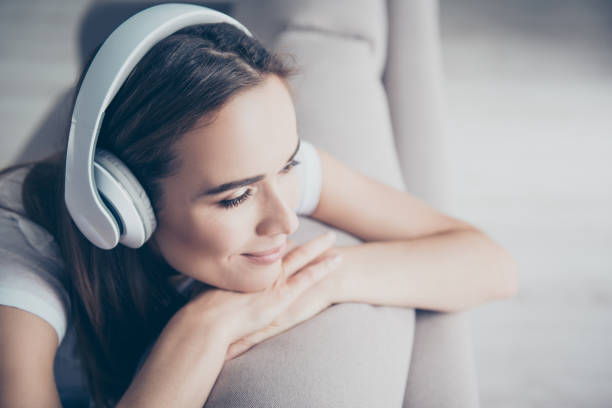 chillout, satisfaction, therapy, wellness, leisure, lifestyle mode. charmed adorable brown haired adorable model enjoying to the stereo sound in big modern ear phones in a room, nice break, good-day - listening stock pictures, royalty-free photos & images