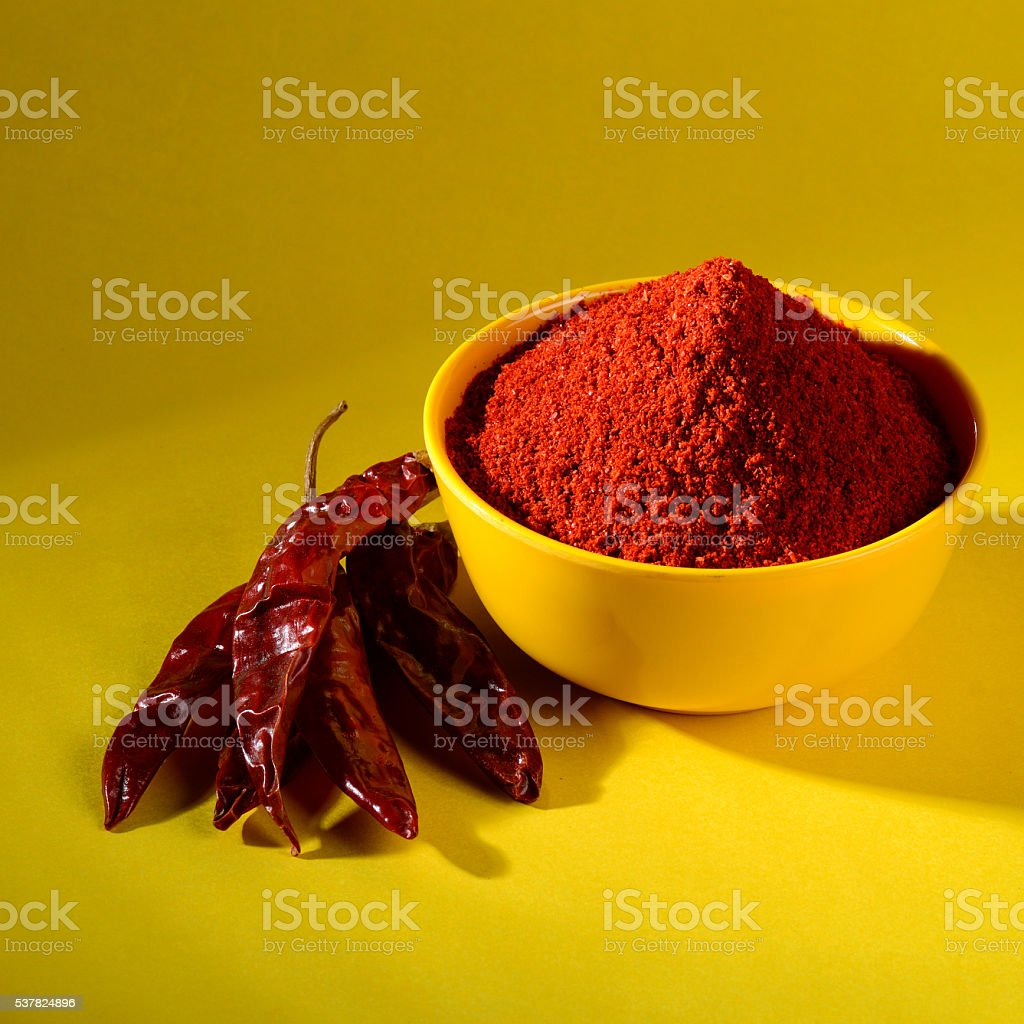 chilly powder with red chilly stock photo