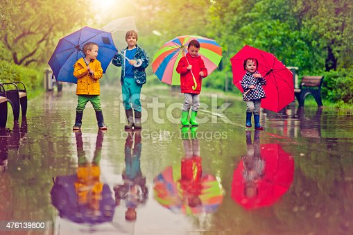 istock Chilren under umbrella 476139800