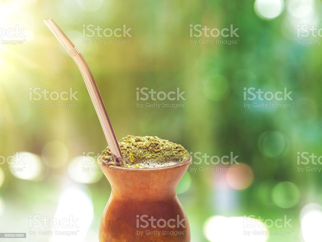 Chimarrao, traditional mate hot tea. Also knowed like mate. On sunny green bokeh background stock photo