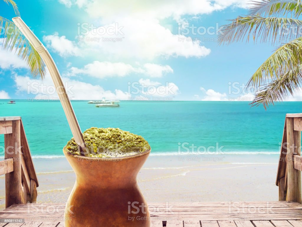 Chimarrao, traditional mate hot tea. Also knowed like mate. On sunny tropical beach landscape background stock photo