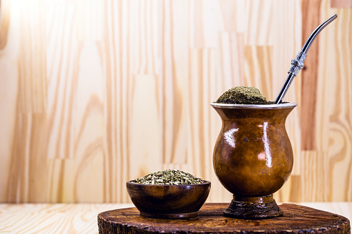 Chimarrão, or mate, is a characteristic drink of the culture of southern South America. mate bowl with mate herb, pump and accessories for preparing mate herb. Space for text.