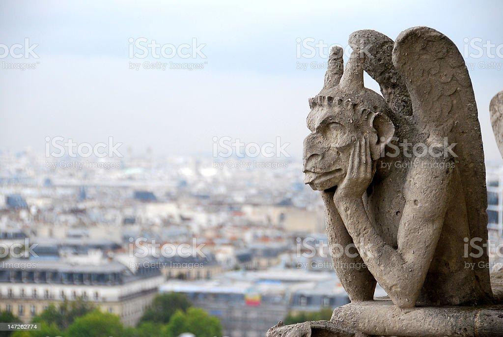 Chimera, grotesque, gargoyle, demon, Notre-Dame Paris, France. September royalty-free stock photo