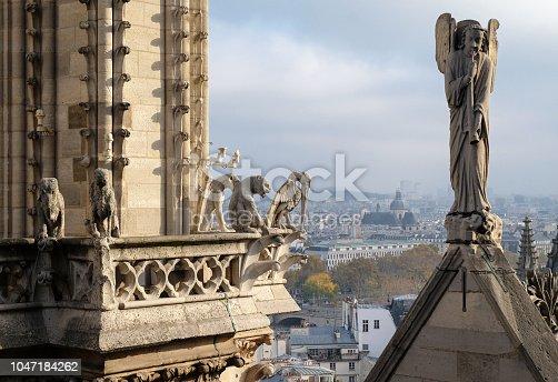 istock Chimeras (gargoyles) of the Cathedral of Notre Dame de Paris overlooking Paris, France 1047184262