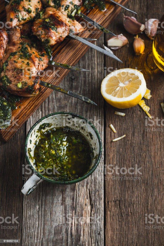 Chimichurri sauce in rural white mug stock photo