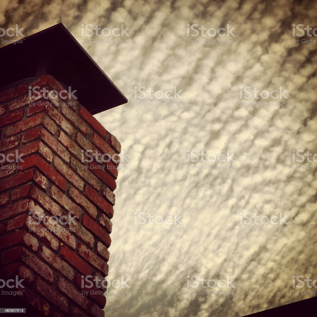 Chimney Against Clouds royalty-free stock photo