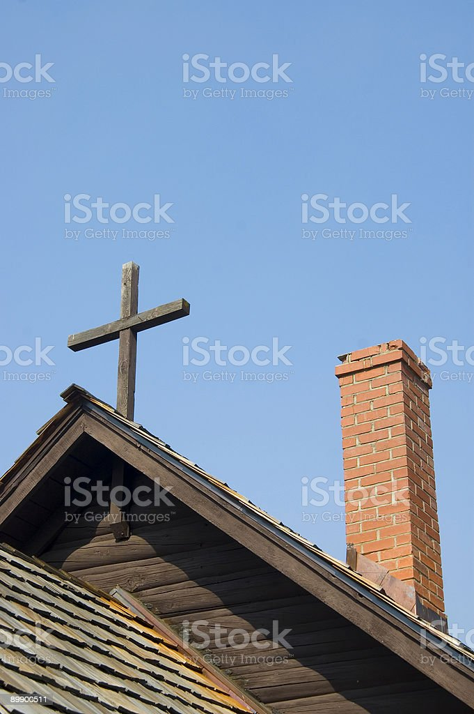 Chimney and cross on church buildin royalty-free stock photo