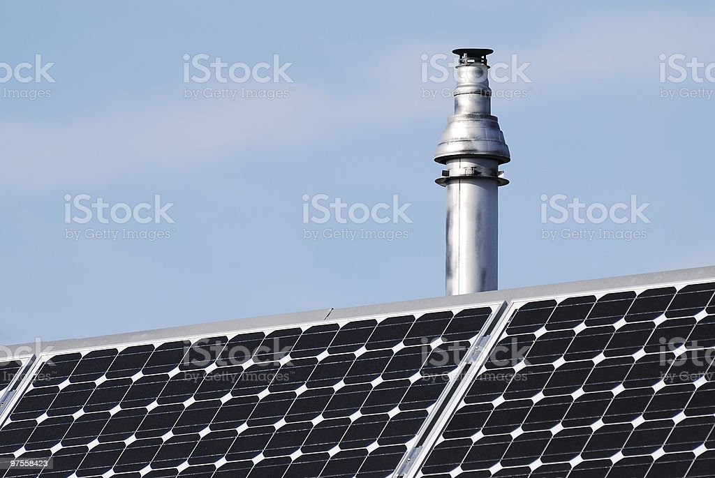 Chimney and photovoltaic cells royalty-free stock photo