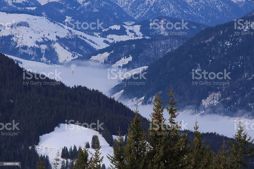 Chimney in the clouds, European Alps pollution or? stock photo