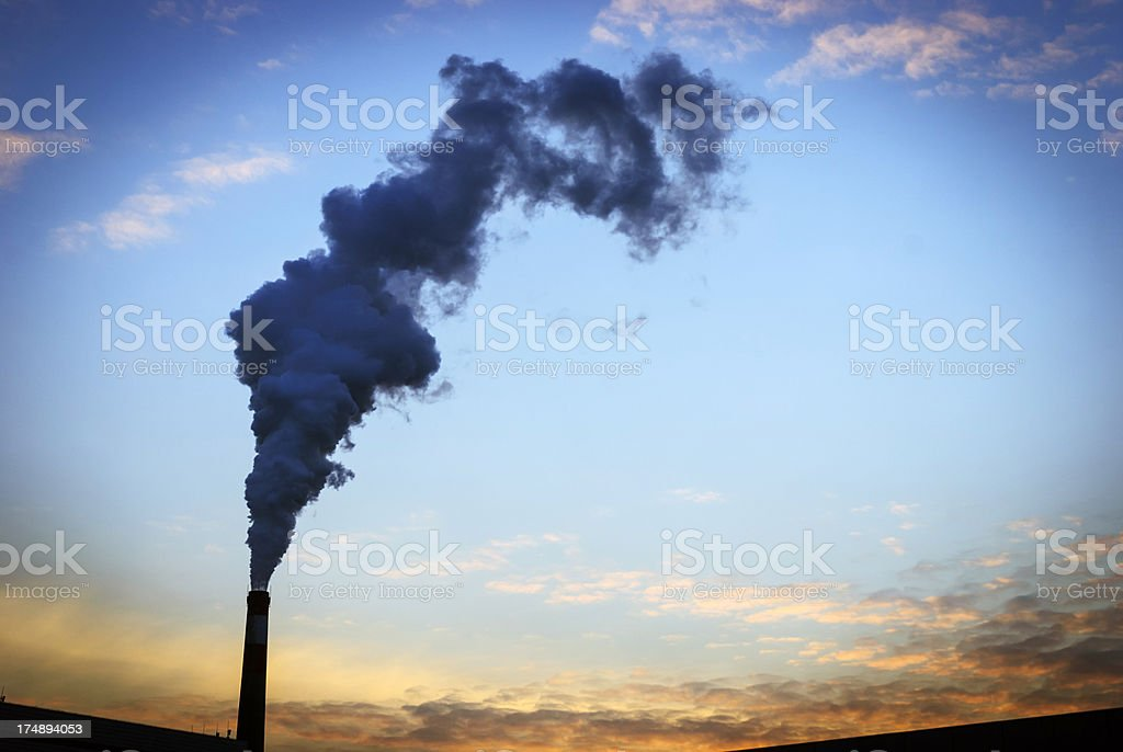 chimney in the sunset royalty-free stock photo