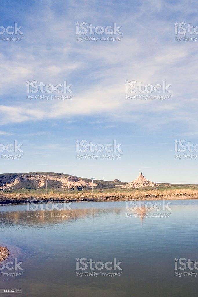 Chimney rock in Nebraska reflected in still water stock photo