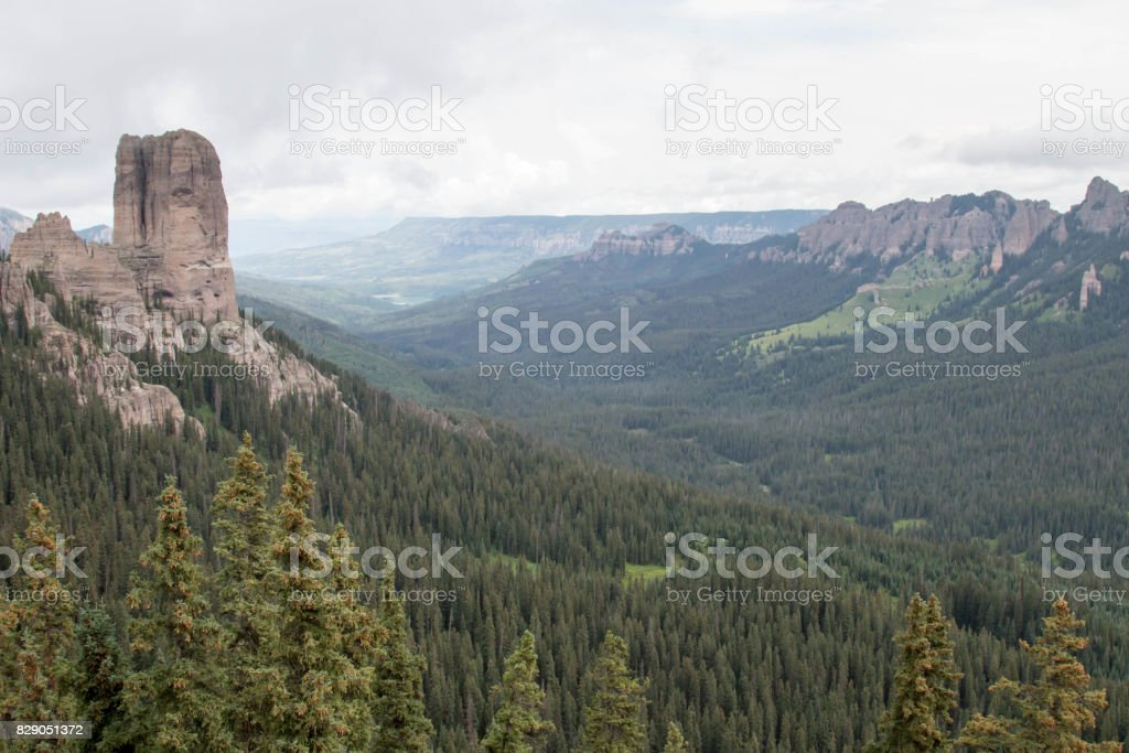 Chimney rock in the Uncompahgre National Forest above a valley stock photo