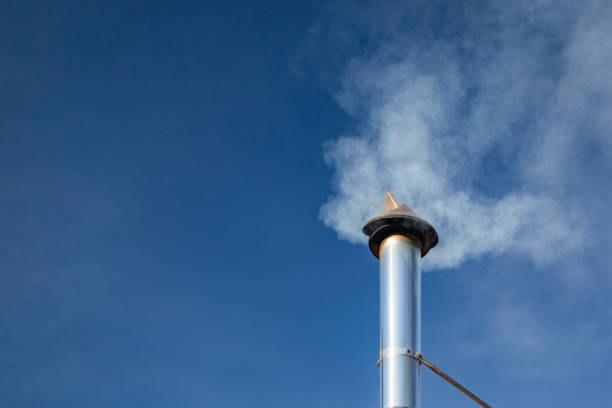 Chimney Smoke Stack with pollution and blue sky, copy space, no people stock photo