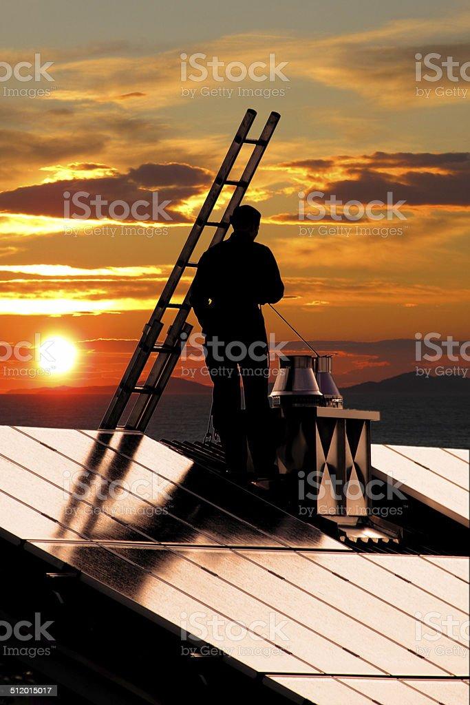 chimney sweeper on sunset stock photo