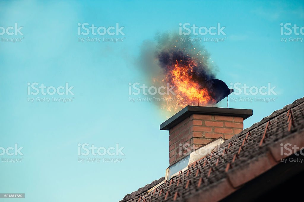Chimney with a fire coming out stock photo