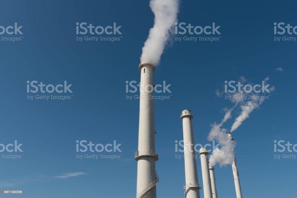 Chimneys blowing white smoke stock photo
