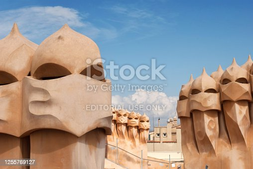 Barcelona, Spain - March 25, 2017: Image taken during the morning from the roof terrace of La Pedrera, also called Casa Milà. The image is a close up of some chimneys