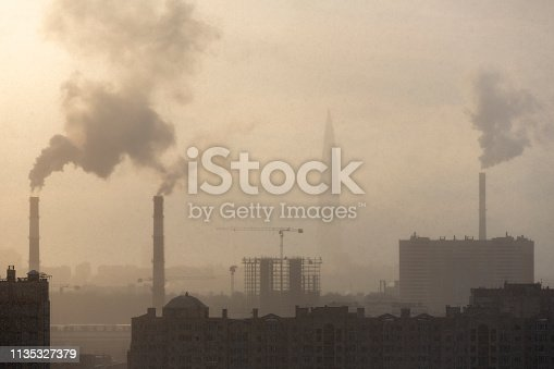Chimneys with smoke in the city