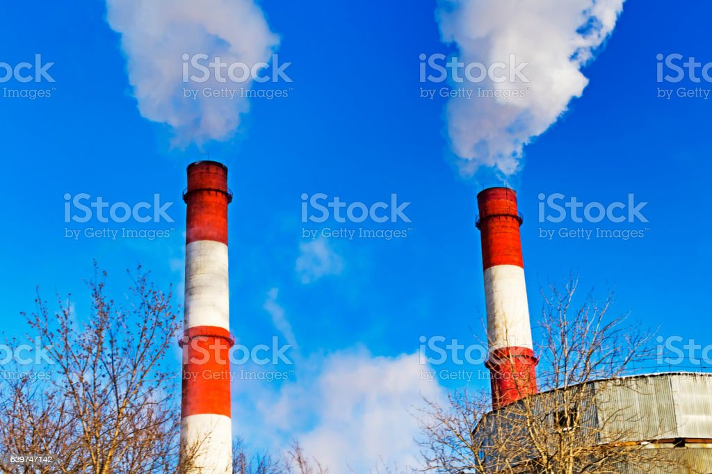 Chimneys with steam production of a thermal power station stock photo