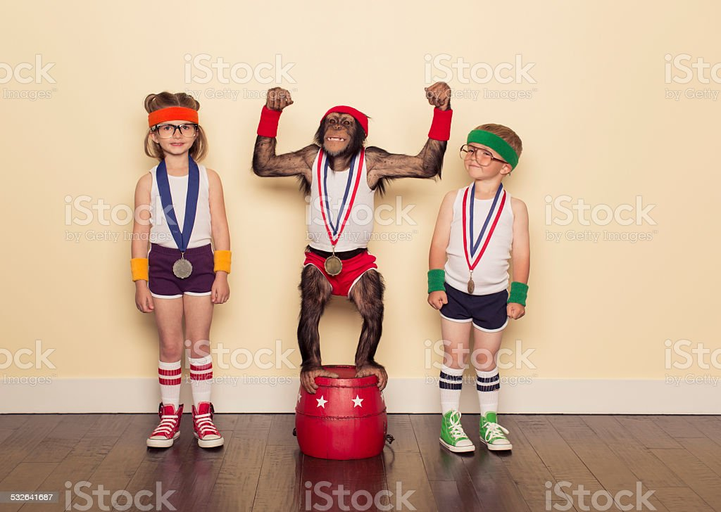 Chimpanzee Champion with Gold Medal and Young Children stock photo