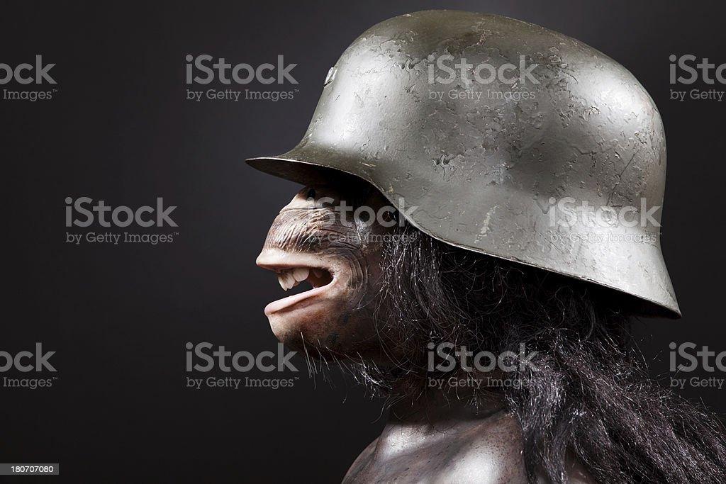Chimpanzee with WWII German Helmet royalty-free stock photo