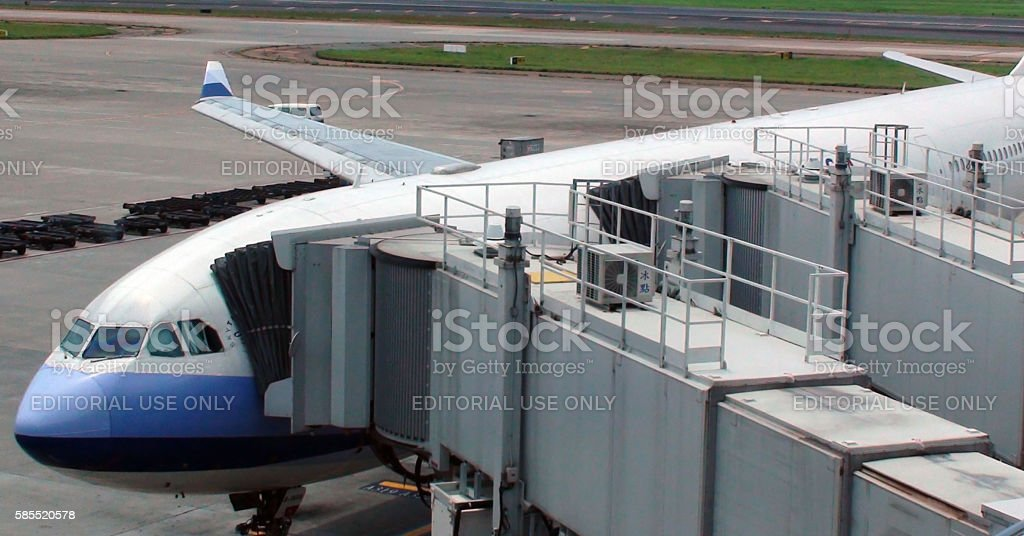 China Airlines Passenger Airplane Parked At Loading And Unloading Gate stock photo