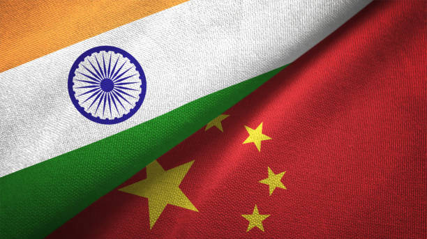 China and India two flags together textile cloth fabric texture stock photo