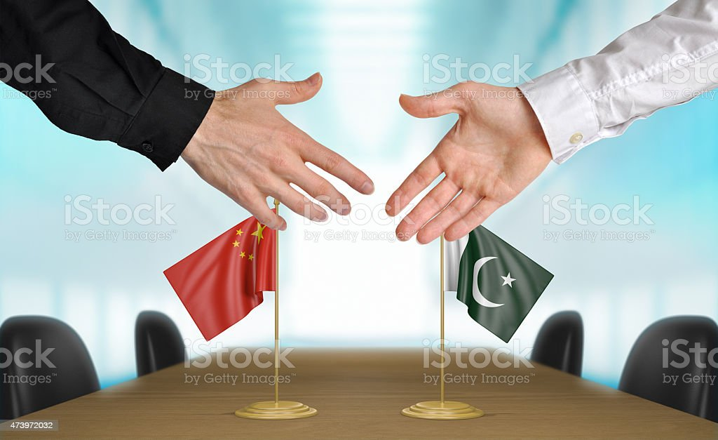 China and Pakistan diplomats agreeing on a deal stock photo