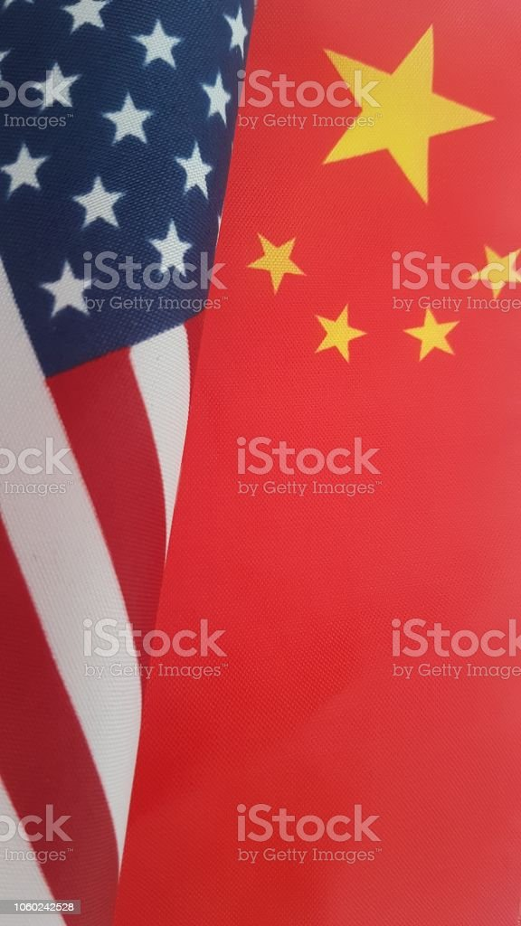 A photo of the Chinese flag and US flag together