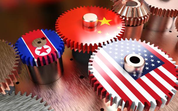 China en USA vlaggen op metalen versnellingen foto