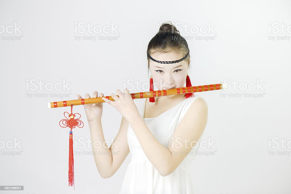 China beauty in blowing the flute stock photo