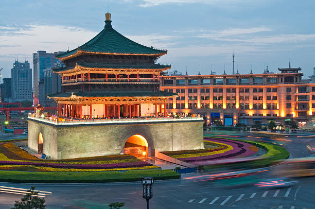 China Bell Tower Xi'an illuminated dusk  bell tower tower stock pictures, royalty-free photos & images