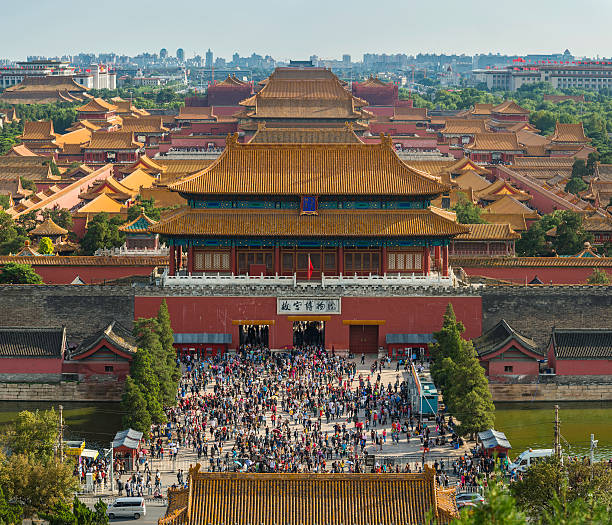 China crowds of people Forbidden City palace gate Beijing China Beijing, China - 1st October 2013: Crowds of tourists during the Golden Week national holiday at the Gate of Divine Might of the Forbidden City, the iconic UNESCO World Heritage Site in the heart of Beijing, China's vibrant capital city. Composite panoramic image created from three contemporaneous sequential photographs. forbidden city stock pictures, royalty-free photos & images