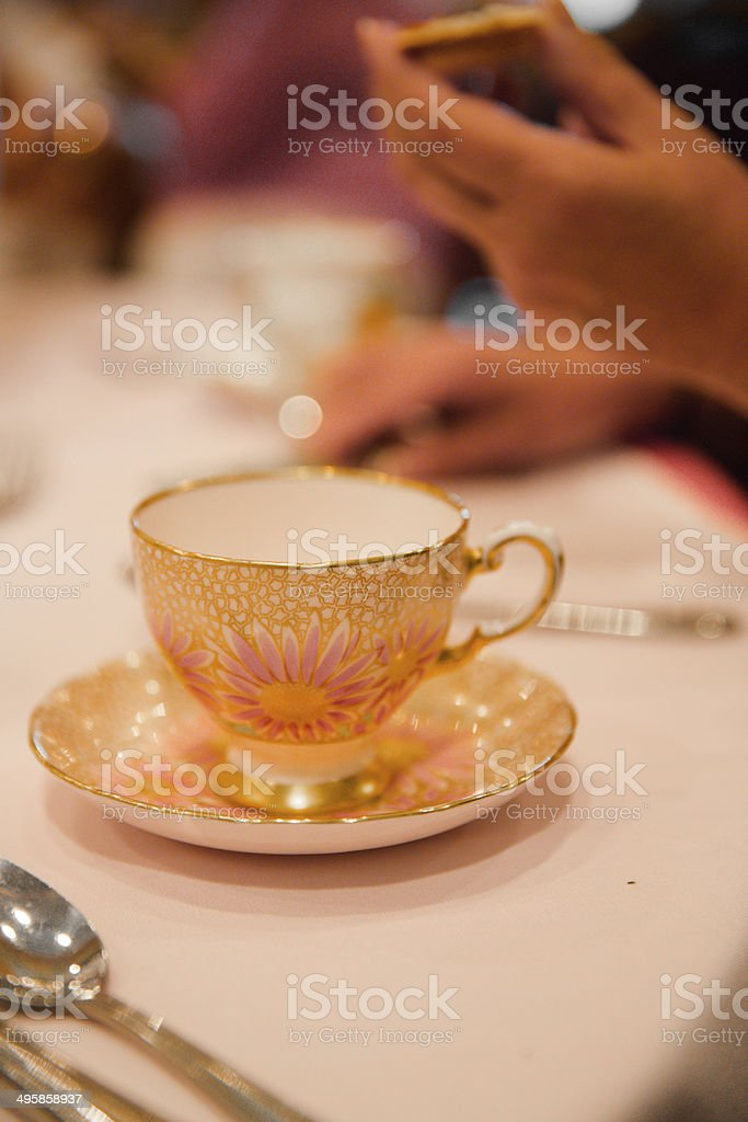 China cup and saucer on a table royalty-free stock photo