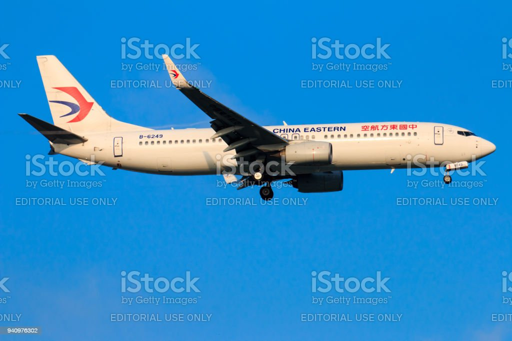 China Eastern airplane landing at Chiangmai international airport in Morning day on September 22,2017 in Chiangmai Thailand stock photo