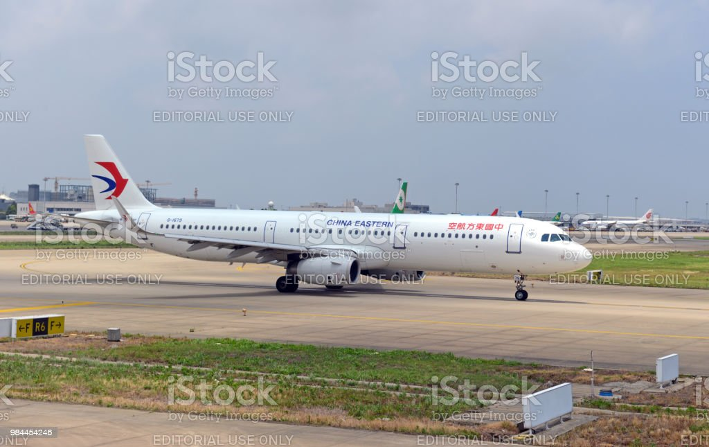 China Eastern plane at airport, an airline carrier making increasing international flights partnering with other global airlines overseas to facilitate air travel. stock photo