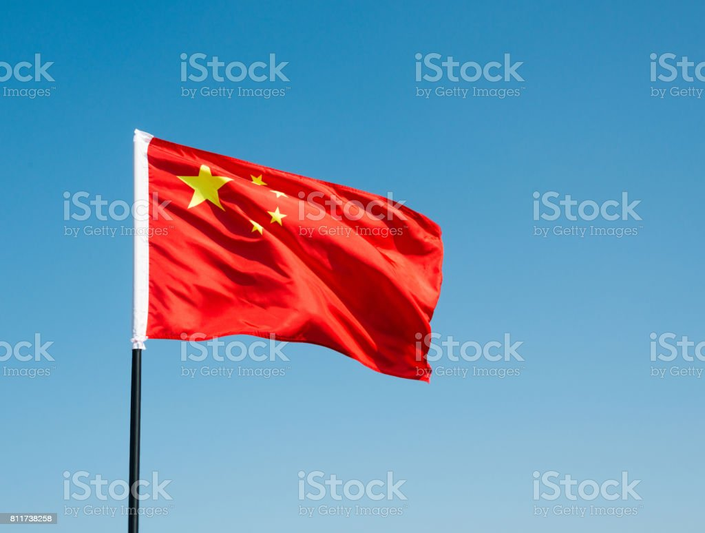 China flag waving against blue sky stock photo